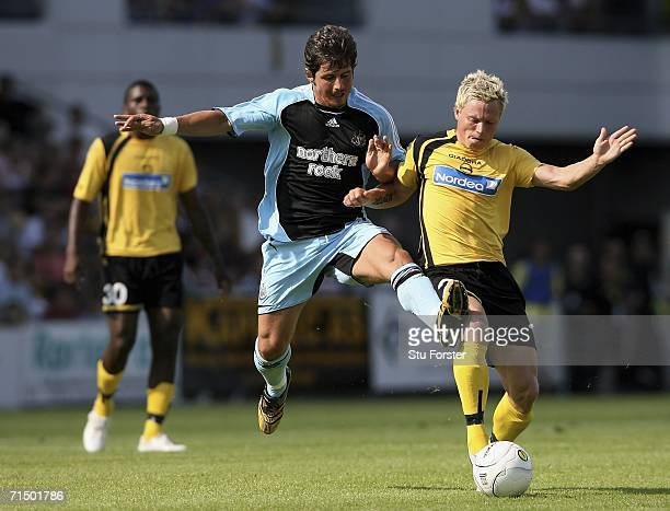 Newcastle palyer Emre attempts to tackle Lillestrom SK player Bjorn Helge Riise during the second leg of the Intertoto Cup between Lillestrom SK and...