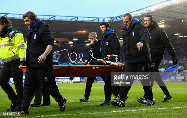 Newcastle player Aleksandar Mitrovic is stretchered off with an injury during The Emirates FA Cup Third Round match between Birmingham City and...