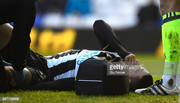 Newcastle player Aleksandar Mitrovic reacts before being stretchered off with an injury during The Emirates FA Cup Third Round match between...