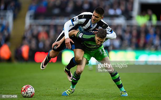 Newcastle player Aleksander Mitrovic races past Federico Fernandez of Swansea during the Barclays Premier League match between Newcastle United and...