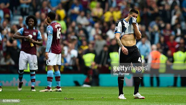 Newcastle player Aleksander Mitrovic reacts after the Barclays Premier League match between Aston Villa and Newcastle United at Villa Park on May 7...