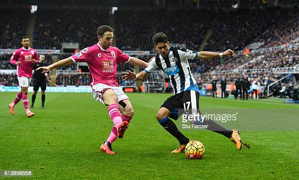 Newcastle player Ayoze Perez is challenged by Marc Pugh during the Barclays Premier League match between Newcastle United at AFC Bournemouth at St...