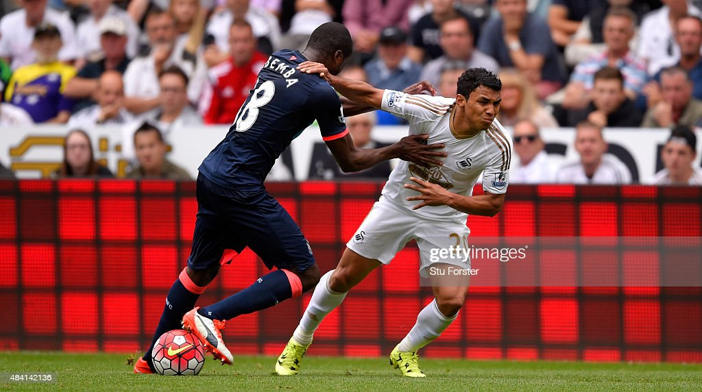 Newcastle player Chancel Mbemba (l) is beaten by Jefferson Montero to the ball during the Barclays Premier League match between Swansea City and Newcastle United at the Liberty stadium on August 15, 2015 in Swansea, United Kingdom.