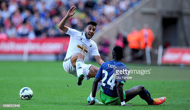 Newcastle player Chieck Tiote beats Neil Taylor to the ball during the Barclays Premier League match between Swansea City and Newcastle United at...