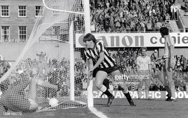 Newcastle player Chris Waddle celebrates a goal as goalkeeper George Wood lies in the back of the net during Newcastle's 3-1 victory over Crystal...