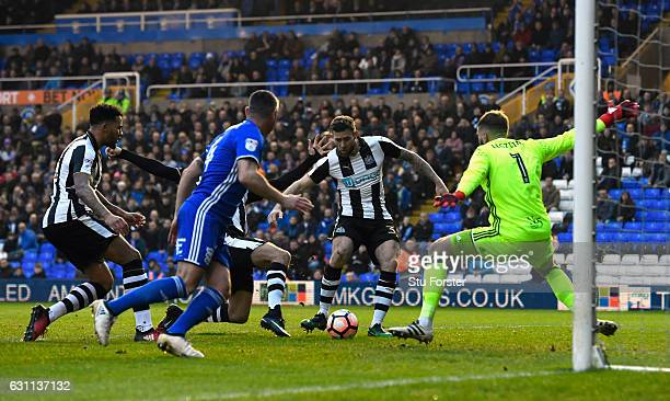 Newcastle player Daryl Murphy scores the opening goal during The Emirates FA Cup Third Round match between Birmingham City and Newcastle United at St...