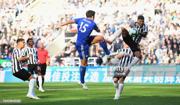Newcastle player DeAndre Yedlin is adjuged to have handled this shot by Leicester player Harry Maguire to give Leicester a penalty during the Premier...