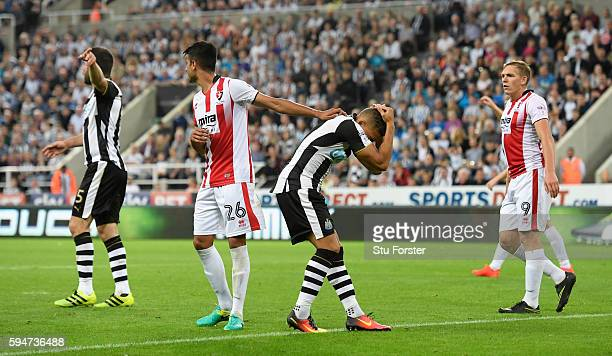 Newcastle player Dwight Gayle reacts after clashing heads during the EFL Cup Round Two match between Newcastle United and Cheltenham Town at St James...