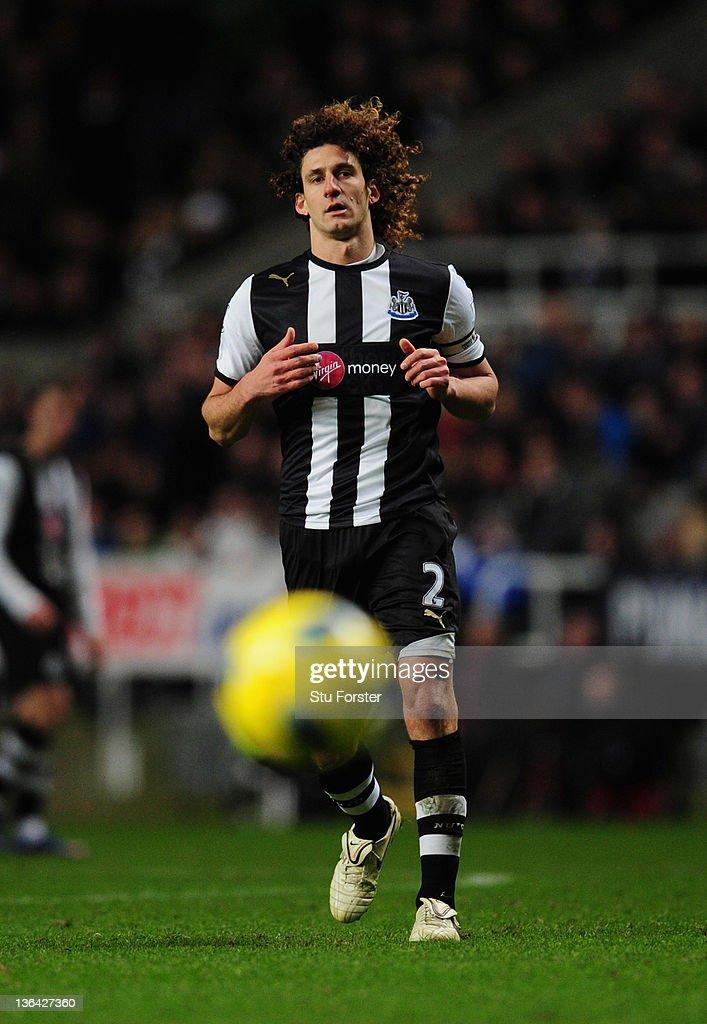 Newcastle player Fabricio Coloccini in action wearing the new sponsors logo during the Barclays Premier league game between Newcastle United and Manchester United at St James' Park on January 4, 2012 in Newcastle upon Tyne, England.