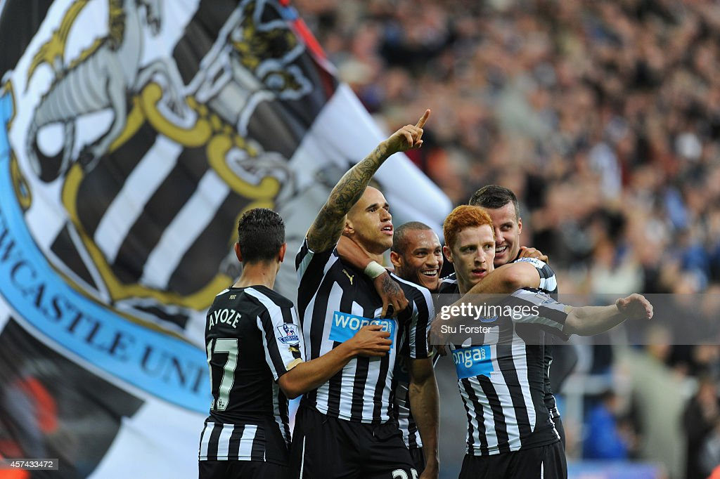 Newcastle player Gabriel Obertan (c) celebrates his goal with team mates during the Barclays Premier League match between Newcastle United and Leicester City at St James' Park on October 18, 2014 in Newcastle upon Tyne, England.