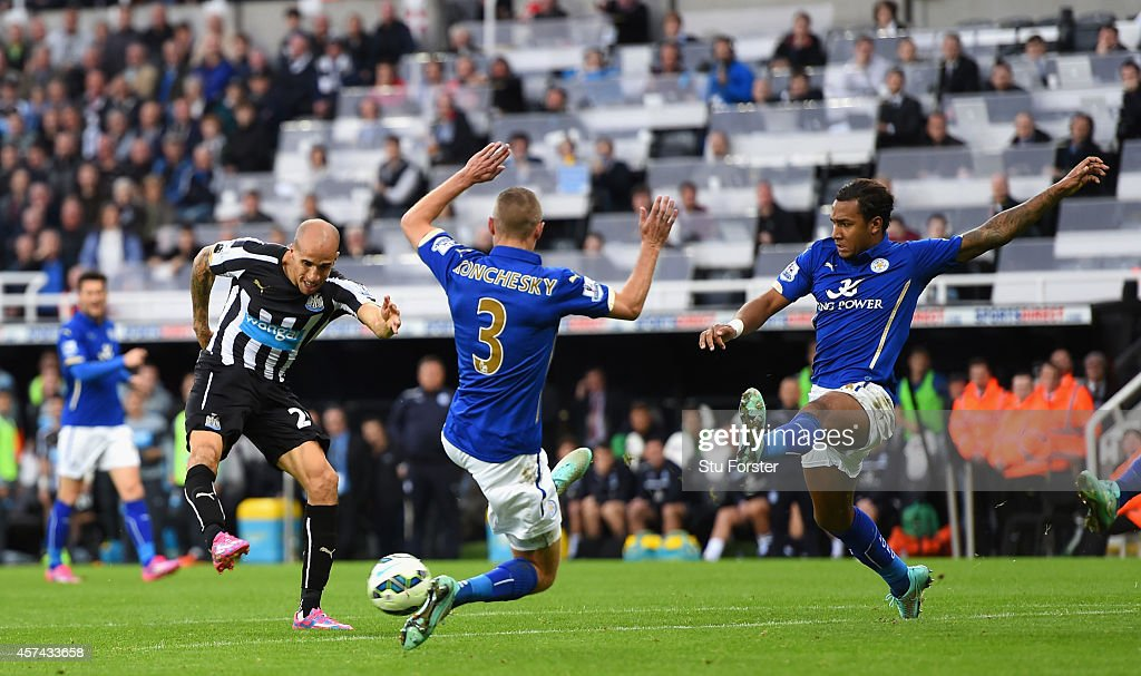 Newcastle player Gabriel Obertan (l) scores the opening goal during the Barclays Premier League match between Newcastle United and Leicester City at St James' Park on October 18, 2014 in Newcastle upon Tyne, England.