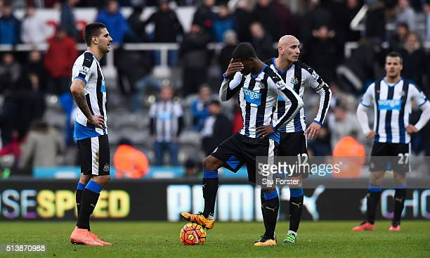 Newcastle player Georginio Wijnaldum reacts as the players wait to restart after the third goal during the Barclays Premier League match between...