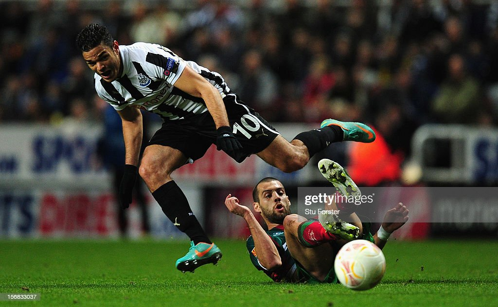 Newcastle player Hatem Ben Arfa (l) rides a challenge during the UEFA Europa League Group match between Newcastle United FC and CS Maritimo at St James' Park on November 22, 2012 in Newcastle upon Tyne, England.
