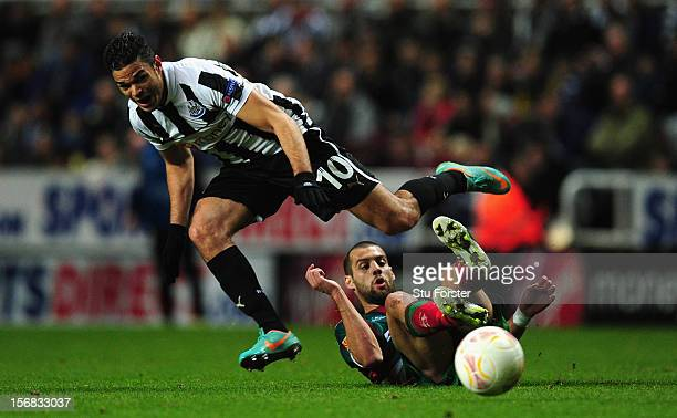 Newcastle player Hatem Ben Arfa rides a challenge during the UEFA Europa League Group match between Newcastle United FC and CS Maritimo at St James'...