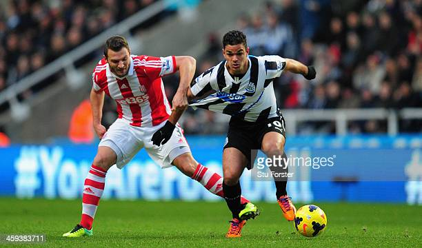 Newcastle player Hatem Ben Arfa tangles with Erik Peters during the Barclays Premier League match between Newcastle United and Stoke City at St...