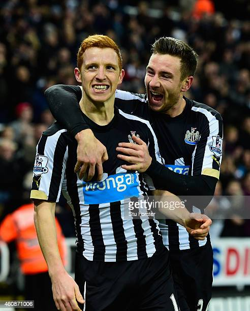 Newcastle player Jack Colback celebrates his goal with Paul Dummett during the Barclays Premier League match between Newcastle United and Everton at...