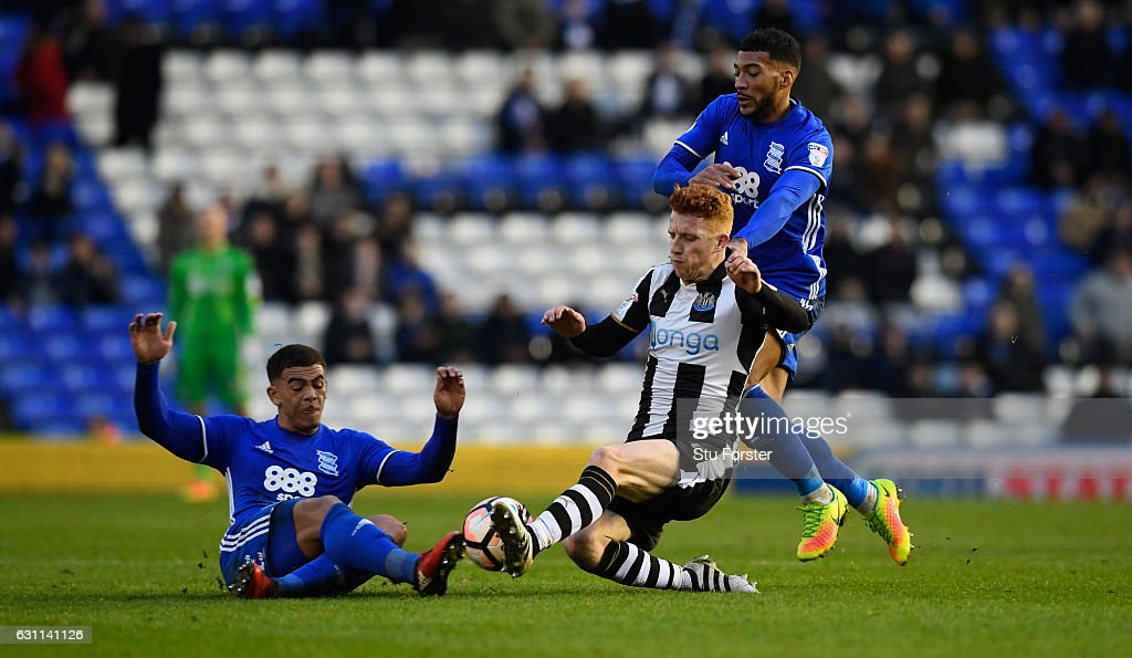Newcastle player Jack Colback (r) challenges Che Adams (l) of Birmingham during The Emirates FA Cup Third Round match between Birmingham City and Newcastle United at St Andrews (stadium) on January 7, 2017 in Birmingham, England.