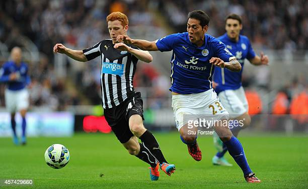 Newcastle player Jack Colback challenges Leonardo Ulloa of Leicester during the Barclays Premier League match between Newcastle United and Leicester...