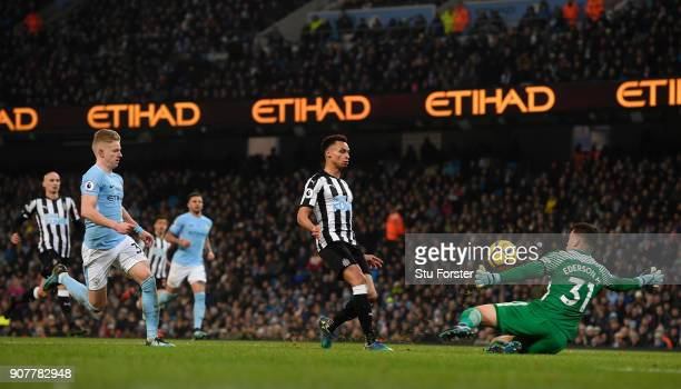 Newcastle player Jacob Murphy scores the Newcastle goal past goalkeeper Ederson during the Premier League match between Manchester City and Newcastle...