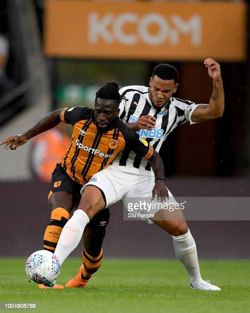 Newcastle player Jamaal Lascelles challenges Hull player Nouha Dicko during a preseason friendly match between Hull City and Newcastle United at KCOM...