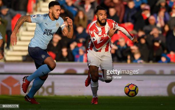 Newcastle player Jamaal Lascelles chases Stoke player Maxim ChoupoMoting during the Premier League match between Stoke City and Newcastle United at...