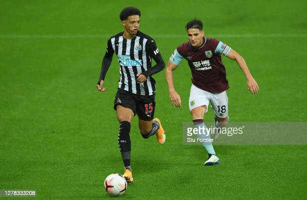 Newcastle player Jamal Lewis in action watched by Ashley Westwood during the Premier League match between Newcastle United and Burnley at St. James...