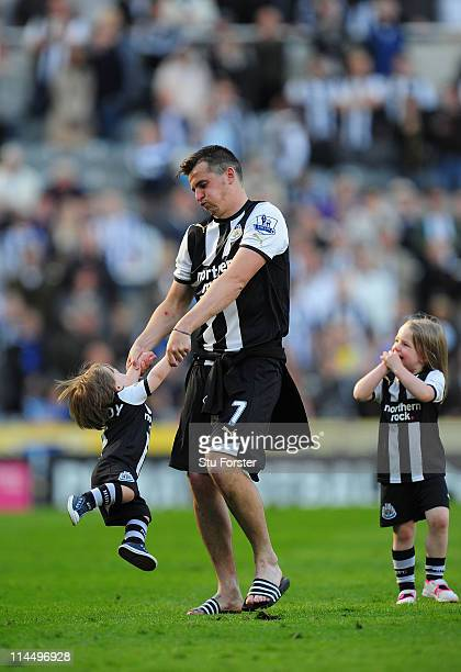 Newcastle player Joey Barton plays with a child after the Barclays Premier League game between Newcastle United and West Bromwich Albion at St James'...