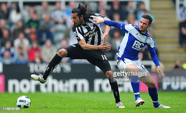 Newcastle player Jonas Gutierrez is challenged by Barry Ferguson of Birmingham during the Barclays Premier League game between Newcastle United and...