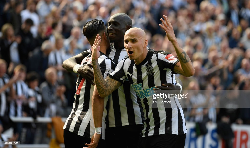 Newcastle player Jonjo Shelvey (r) celebrates with goalscorer Ayoze Perez (l) and Mo Diame after the second goal during the Premier League match between Newcastle United and Chelsea at St. James Park on May 13, 2018 in Newcastle upon Tyne, England.