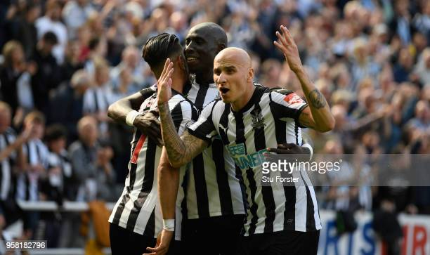 Newcastle player Jonjo Shelvey celebrates with goalscorer Ayoze Perez and Mo Diame after the second goal during the Premier League match between...