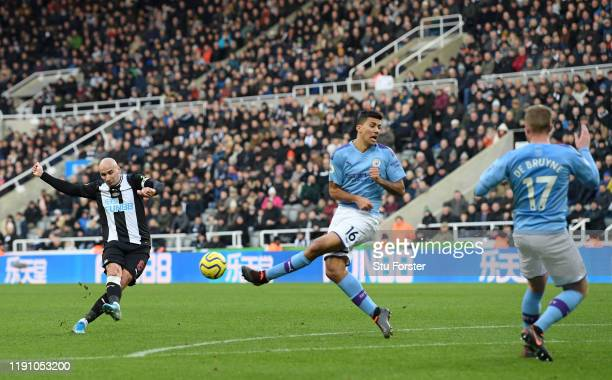 Newcastle player Jonjo Shelvey shoots to score the 2nd Newcastle goal despite the attentions of city players Rodri and Kevin De Bruyne during the...