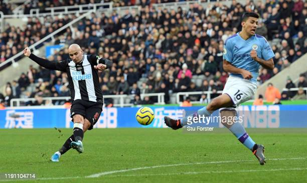 Newcastle player Jonjo Shelvey shoots to score the 2nd Newcastle goal despite the attentions of city player Rodri during the Premier League match...