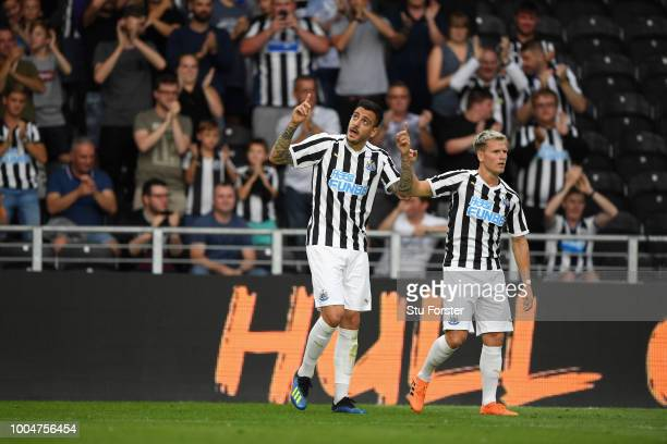 Newcastle player Joselu celebrates the opening goal with Matt Ritchie during a preseason friendly match between Hull City and Newcastle United at...