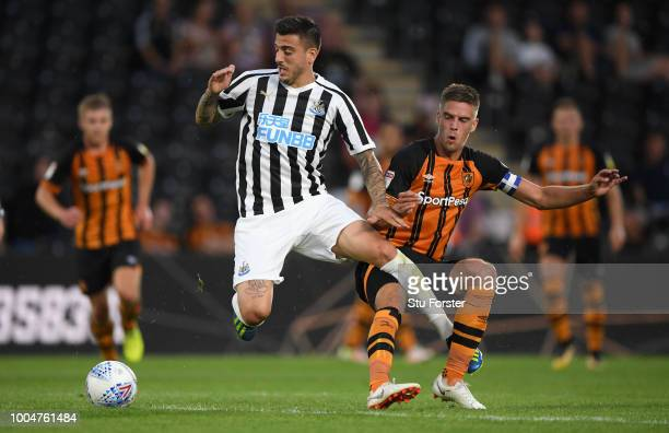 Newcastle player Joselu is fouled by Hull captain Marcus Henriksen during a preseason friendly match between Hull City and Newcastle United at KCOM...