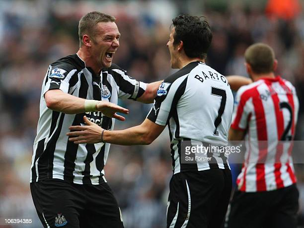 Newcastle player Kevin Nolan celebrates his first goal with Joey Barton during the Barclays Premier League match between Newcastle United and...