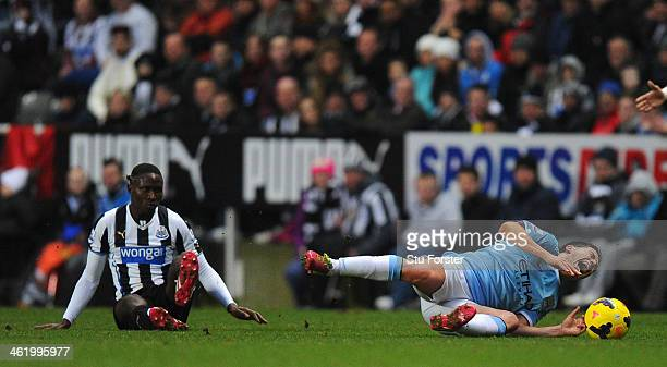 Newcastle player Mapou YangaMbiwa fouls Samir Nasri who is later stretchered off during the Barclays Premier League match between Newcastle United...