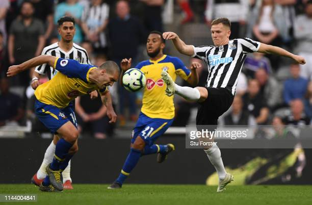 Newcastle player Matt Ritchie challenges Oriol Romeu during the Premier League match between Newcastle United and Southampton FC at St. James Park on...