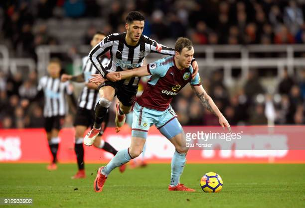 Newcastle player Mikel Merino challenges Ashley Barnes of Burnley during the Premier League match between Newcastle United and Burnley at St James...
