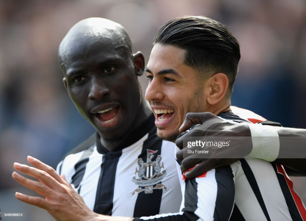 Newcastle player Mohammed Diame (l) congratulates goalscorer Ayoze Perez during the Premier League match between Newcastle United and Arsenal at St. James Park on April 15, 2018 in Newcastle upon Tyne, England.