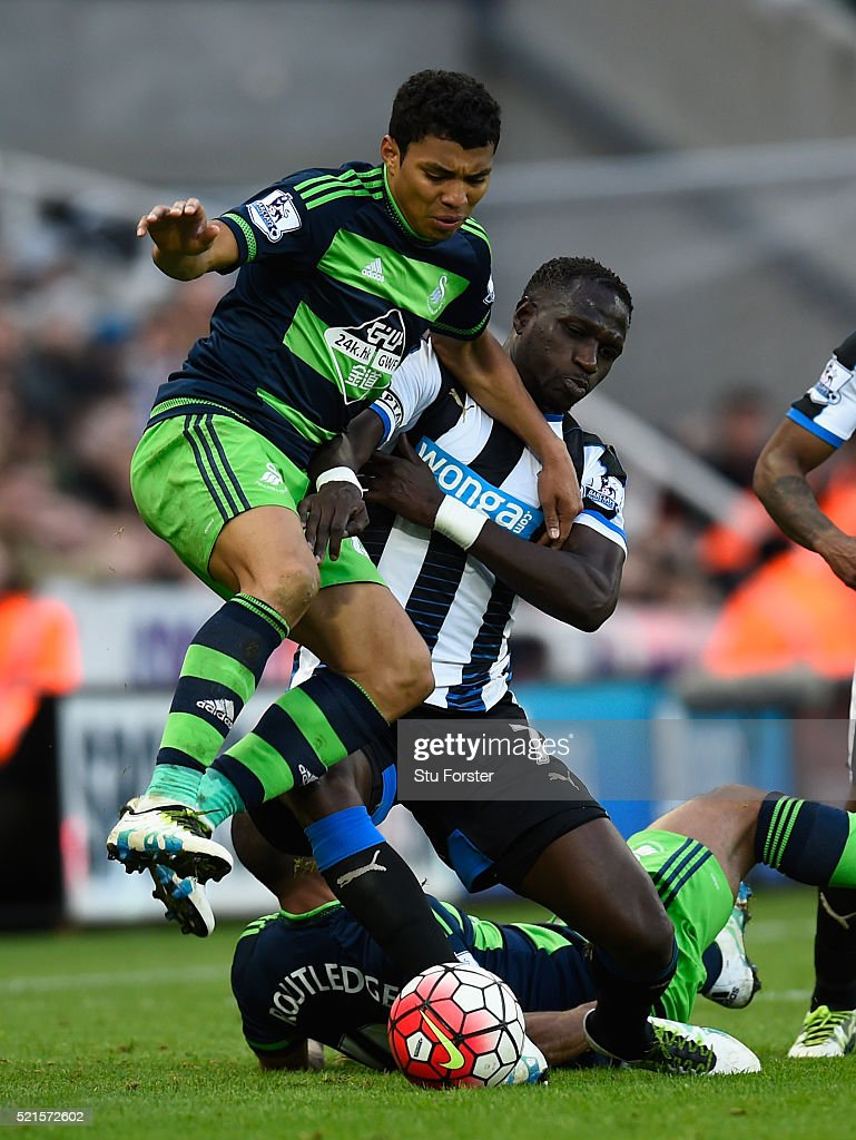 Newcastle player Moussa Sissoko challenges Jefferson Montero of Swansea during the Barclays Premier League match between Newcastle United and Swansea City at St James' Park on April 16, 2016 in Newcastle Upon Tyne, England.