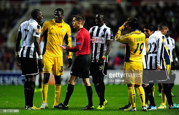 Newcastle player Moussa Sissoko has words with referee Tom Harald Hagen during the UEFA Europa League Round of 32 first leg match between Newcastle...
