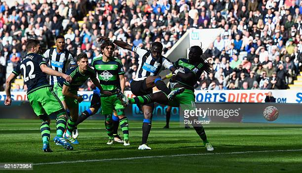 Newcastle player Moussa Sissoko shoots to score the second Newcastle goal during the Barclays Premier League match between Newcastle United and...