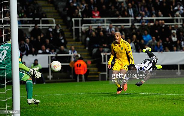 Newcastle player Papiss Cisse has his last minute header saved by goalkeeper Olexandr Goryainov during the UEFA Europa League Round of 32 first leg...
