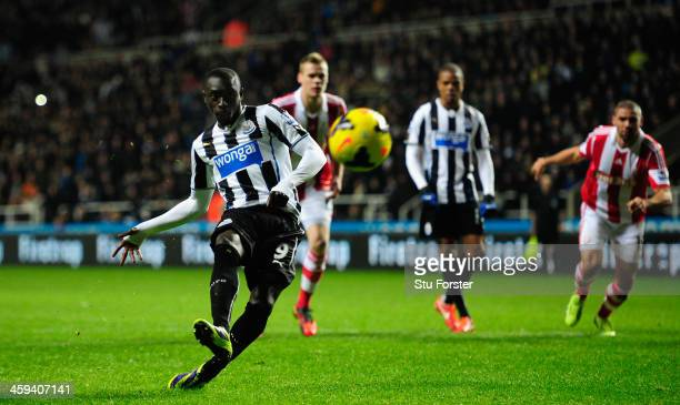 Newcastle player Papiss Cisse tucks the fifth goal away ftrom the Penalty spot during the Barclays Premier League match between Newcastle United and...