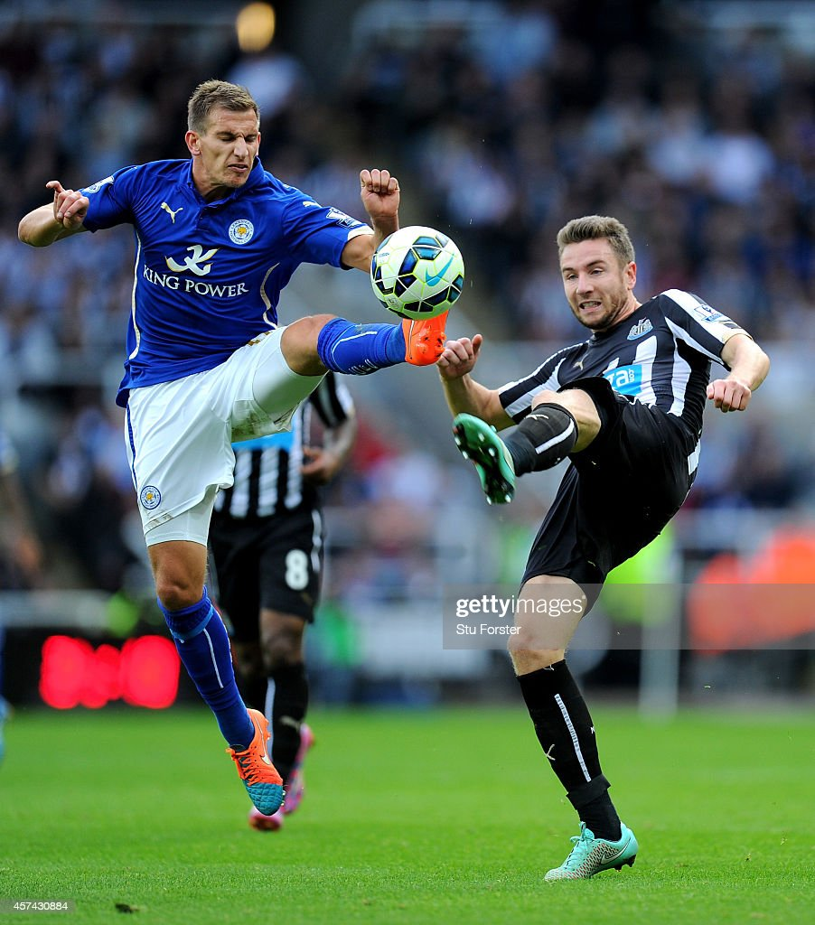 Newcastle player Paul Dummett (r) challenges Marc Albrighton during the Barclays Premier League match between Newcastle United and Leicester City at St James' Park on October 18, 2014 in Newcastle upon Tyne, England.
