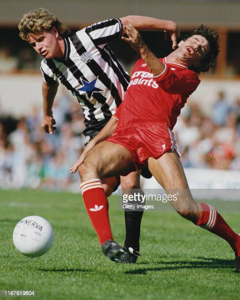 Newcastle player Paul Gascoigne holds off the challenge of Mark Lawrenson during a Division 1 match between Newcastle United and Liverpool at St...