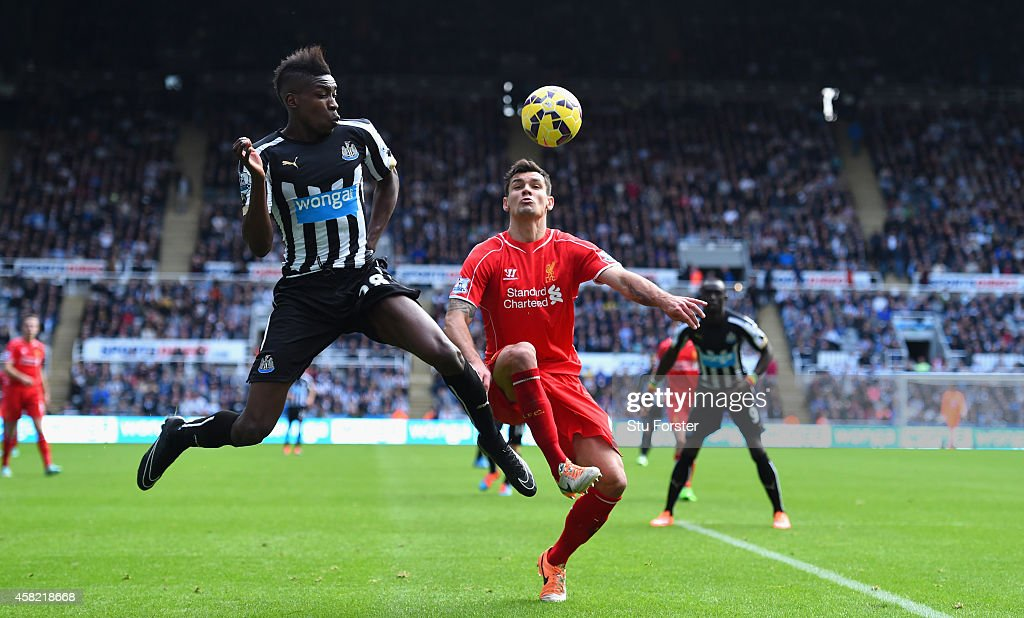 Newcastle player Sammy Ameobi (l) challenges Dejan Lovren during the Barclays Premier League match between Newcastle United and Liverpool at St James' Park on November 1, 2014 in Newcastle upon Tyne, England.