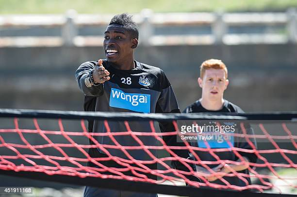 Newcastle player Sammy Ameobi gestures during a Newcastle United Training Session at the Longsands beach in Tynemouth on July 09 in Newcastle upon...