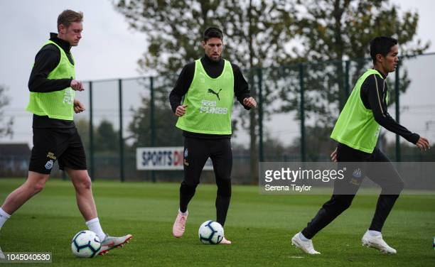 Newcastle player seen LR Sean Longstaff Federico Fernandez and Yoshinori Muto control the ball during the Newcastle United Training session at The...