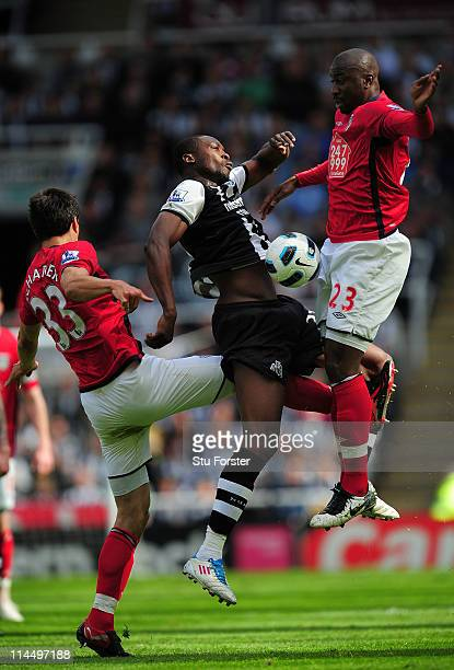 Newcastle player Shola Ameobi is challenged by Paul Scharner and Abdoulaye Meite during the Barclays Premier League game between Newcastle United and...